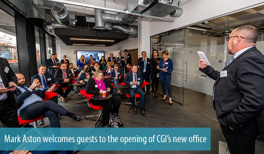 Mark Aston welcomes guests to the opening of CGIs new office