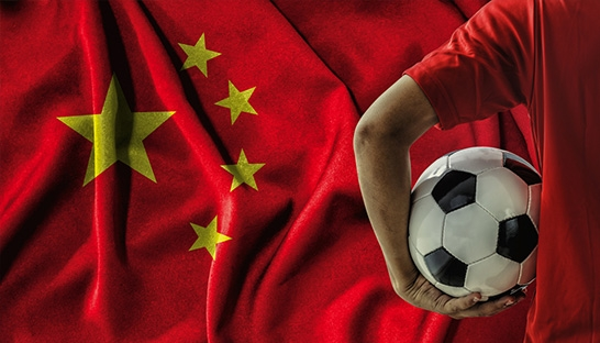 Debt-ridden Chinese football plays a risky game