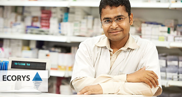 Man behind the counter of a drugstore in India - Ecorys